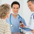 Doctor Prescribing Medication To Patient — Stock Photo