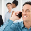 Smiling Businessman Talking On Cell Phone — Stock Photo