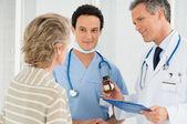 Doctor Prescribing Medication To Patient — Stock Photo