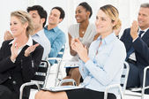 Group Of Businesspeople Clapping In Seminar — Stock Photo