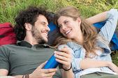 Young Couple Lying On Meadow — Stock Photo