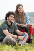 Couple of hikers have a break — Stock Photo