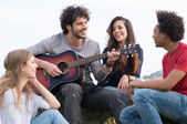 Group Of Friends With Guitar — Stockfoto