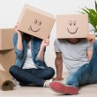 Couple having fun while moving home — Stock Photo #50521091