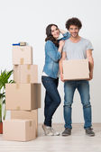 Couple Standing Near Stack Of Boxes — Stock Photo
