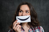 Woman Holding Smiley Emoticon — Stock Photo