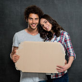 Couple Holding Cardboard Banner — Stock Photo