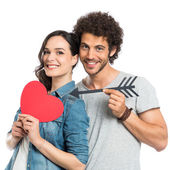 Loving Couple Holding Arrow And Heart — Stock Photo