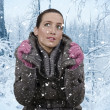 Woman and snowfall — Stock Photo