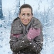 Stock Photo: Woman and snowfall