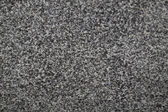 Closeup of dark grey granite texture — Stock Photo