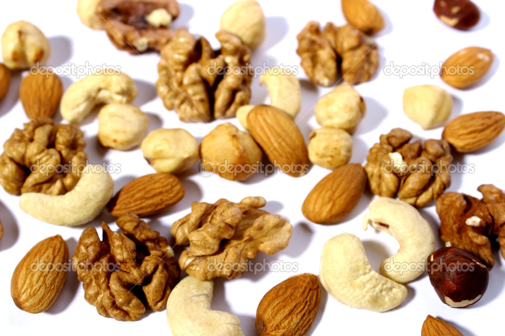 Nuts, assorted nuts, cashews, almonds, hazelnuts, walnuts,   Stock Photo #12555719