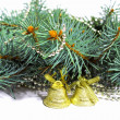 Fir branches, garland, with a bell - Stock Photo