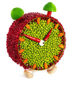 Fruit and vegetable volume clock — Stock Photo