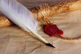 Old paper, ancient parchment scroll, envelope with wax seal and quill pen — Stock Photo