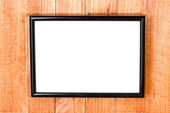 Wooden picture frame on a wooden blue background — Stock Photo