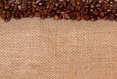Coffee beans. On sackcloth, background — Stock Photo