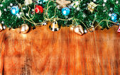 Christmas border with decoration, ornament on a wooden background — Stock Photo