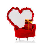 Heart and gift on the couch. Valentines Day — Stock Photo