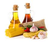 Ingredients for pasta. Spaghetti, chili, oil, garlic isolated on white — Stock Photo