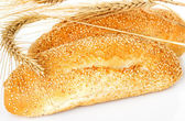 Bun, bread with spikelets — Stock Photo