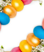 Easter background with eggs and spring flowers, text space — Foto de Stock