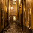 Narrow street in Stockholm Old town at night. - Stock Photo