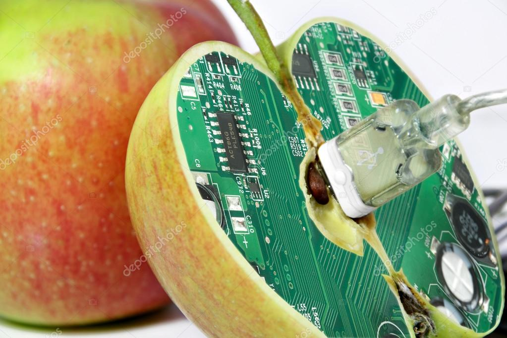 Apple with technology core - humorous concept for gmo food — Stock Photo #12256684