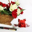 Writing loving letter - table with roses — Stock Photo #12693256