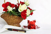 Writing a loving letter - table with roses — Stock Photo