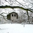 Stone bird house in winter - Photo