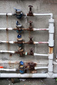 Pipes & meters of a neighborhood — Stock Photo