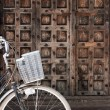 Zanzibar door with a bike in front — Stock Photo