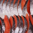 Fresh orange-red salmon slices — Stock Photo