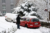 Remove snow from car — Stok fotoğraf