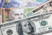 Canadian dollars vs. US dollars — Stock Photo
