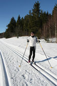 A senior man is doing cross-country skiing — Stock Photo
