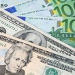 US Dollar and Euro - Stock Photo