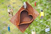 Heart locks on a bridge — Stock Photo