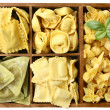Assorted pastwith fillings in wooden box — Stock Photo #17699103