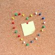 Post-it note in the heart-shaped pins — Stock Photo