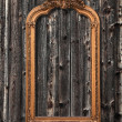 Classic mirror frame on a wooden wall — Stock Photo