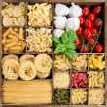 Assorted pastas in wooden box — Stock Photo