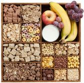 Assorted cereals with fruits and milk — Stock Photo