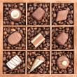 Stock Photo: Assorted chocolates and coffee beans