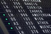 Airport flight information Board — Stock Photo