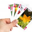 Stock Photo: Hand holding playing card showing autumn leaf