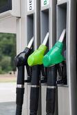 Fuel pistols at Petrol station — Stock Photo