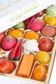Chocolate box with vegetable and fruit contents - diet concept — Stock Photo