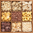 Assorted cereals in wooden box — Stock Photo